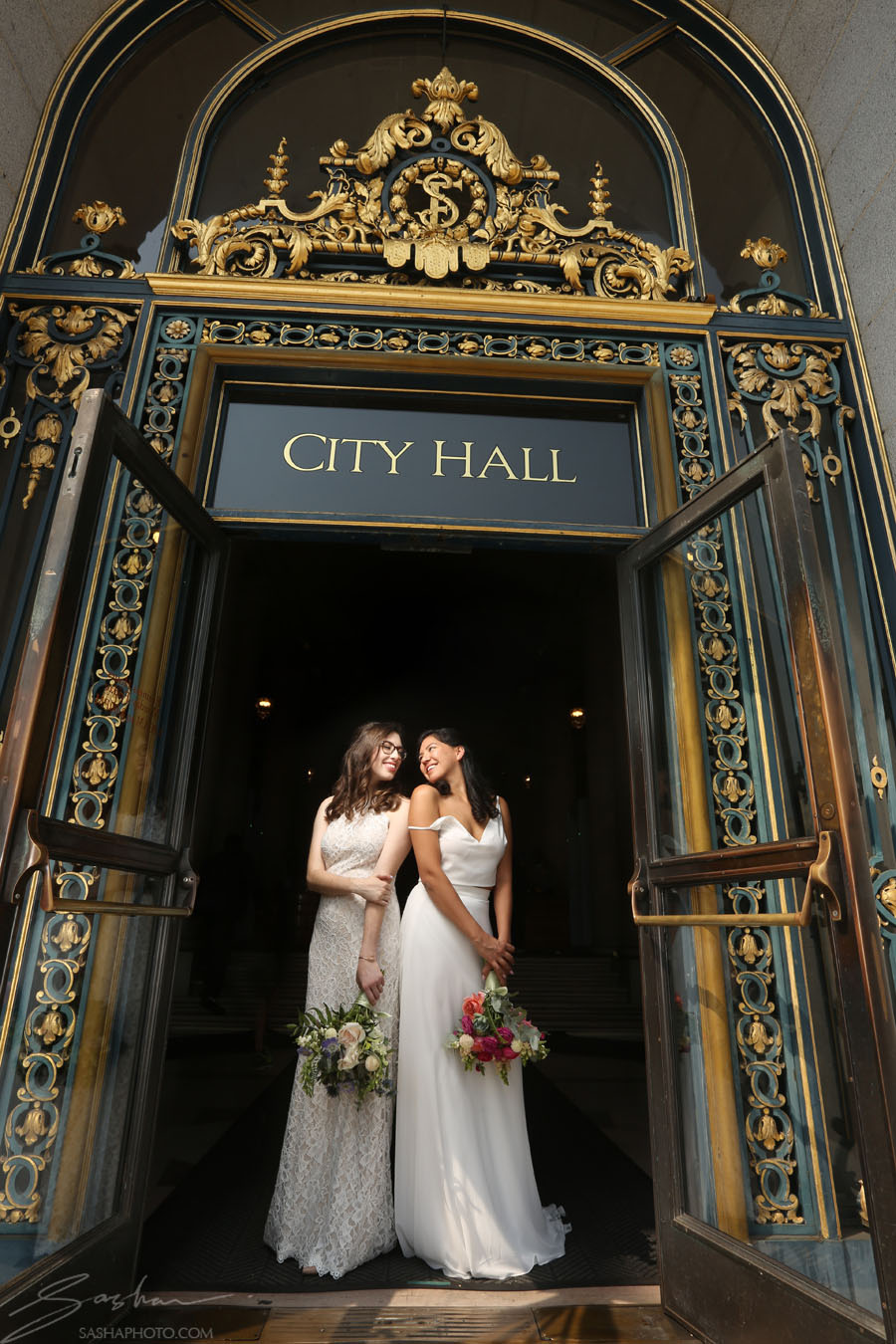 same sex couple in front of city hall doors