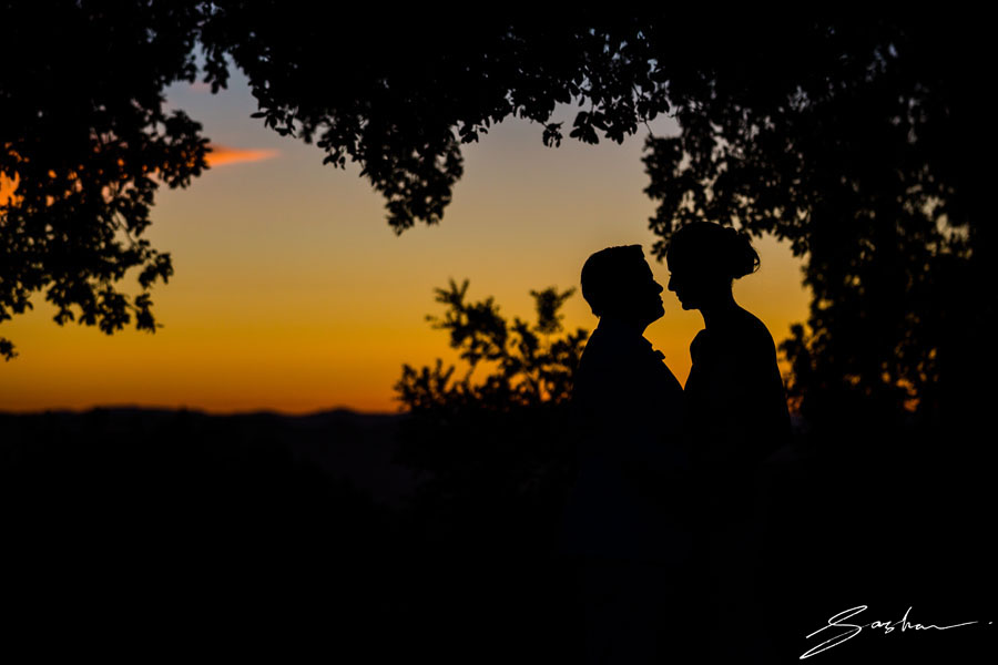 two brides sunset silhouette