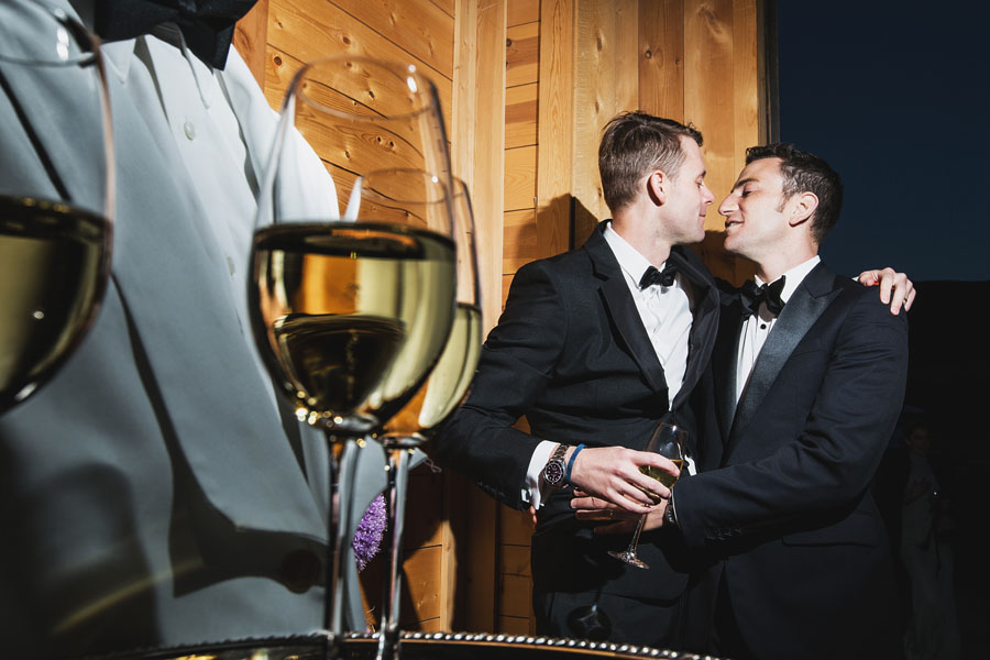 two groom kissing