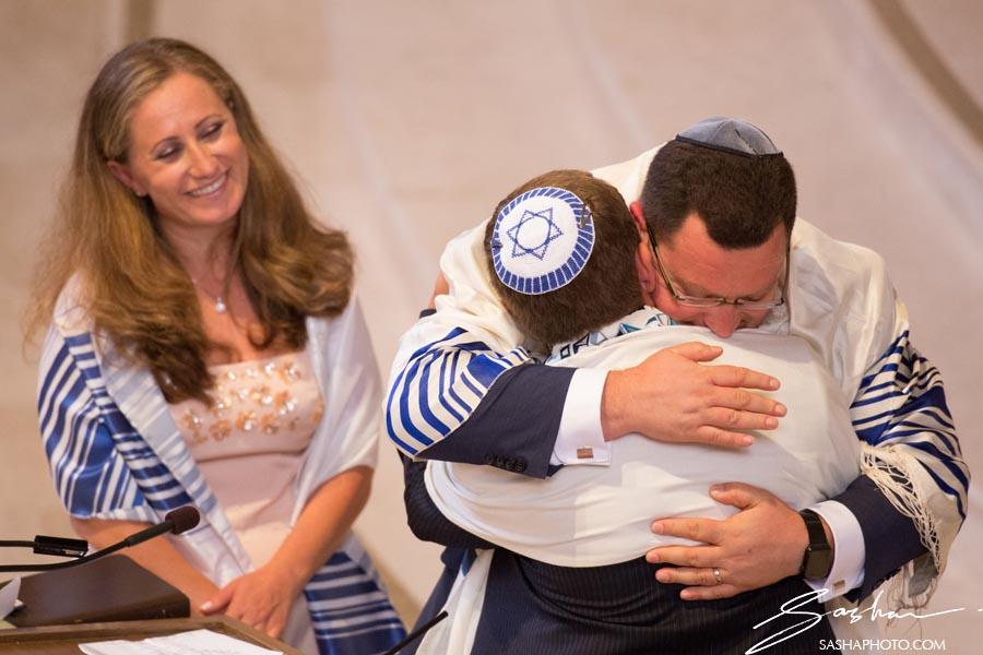 father hugs son bar mitzvah