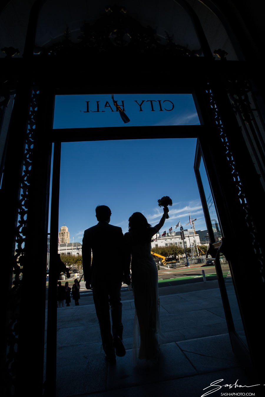 bride and groom exiting city hall silhouette