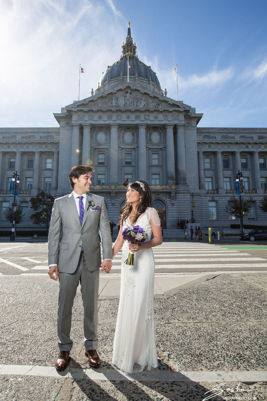 bride and groom in front of city hall