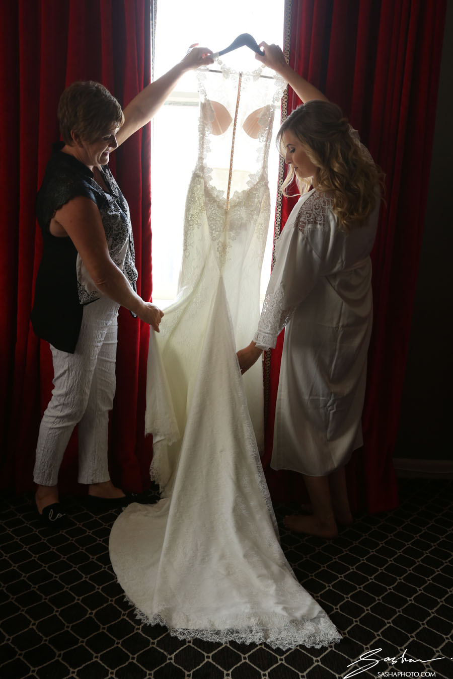 bride and mother with wedding gown