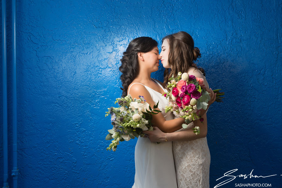 blue wall wedding portrait