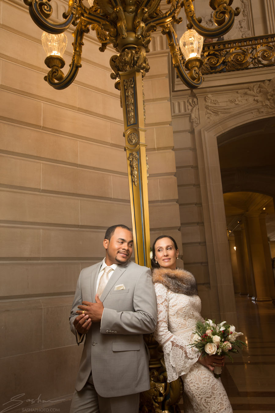 bride and groom in front of city hall lamp