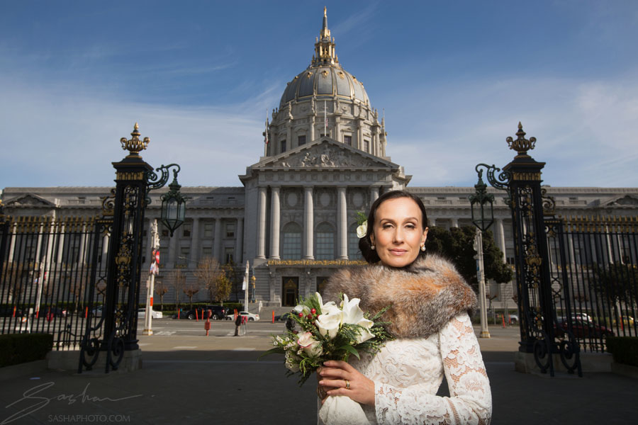 bride posting in front of san francisco city hall