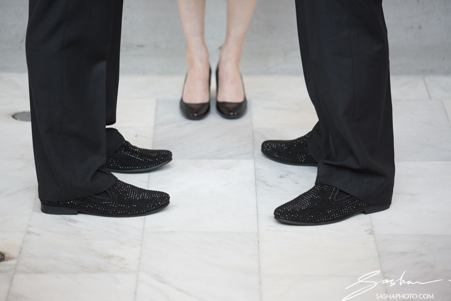 two grooms and wedding officiant shoe shot