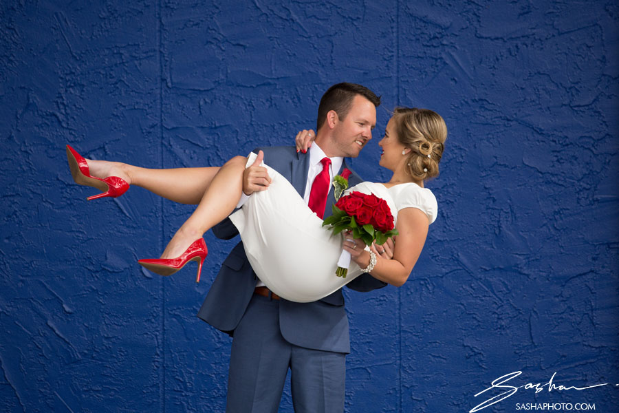 red wedding shoes red wedding pumps blue background