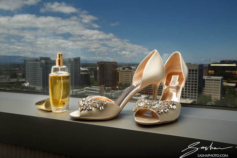 badgley mischka wedding shoes on window sill