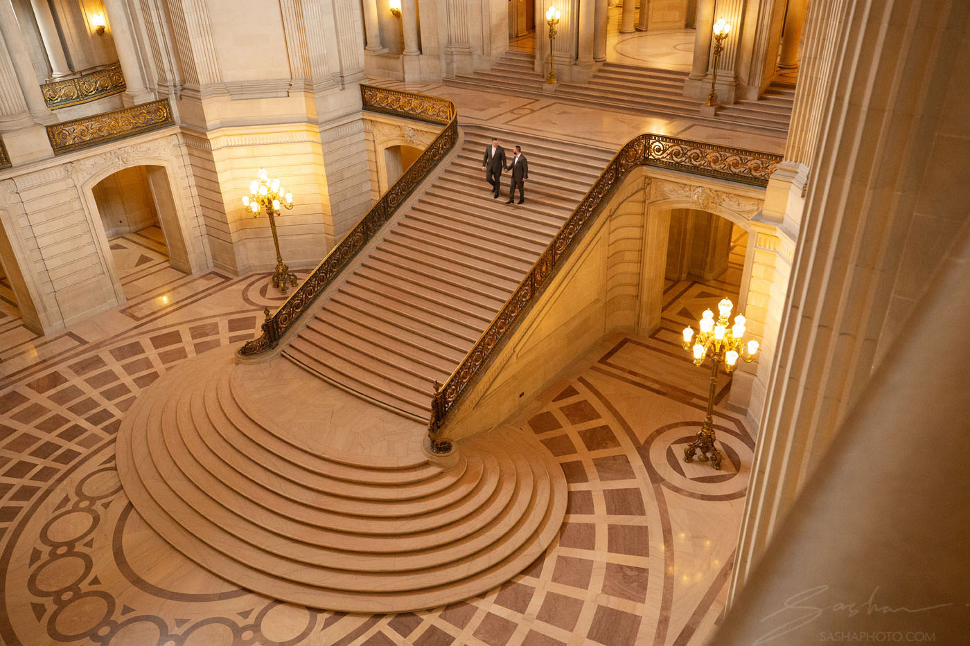 same sex couple staircase sf city hall
