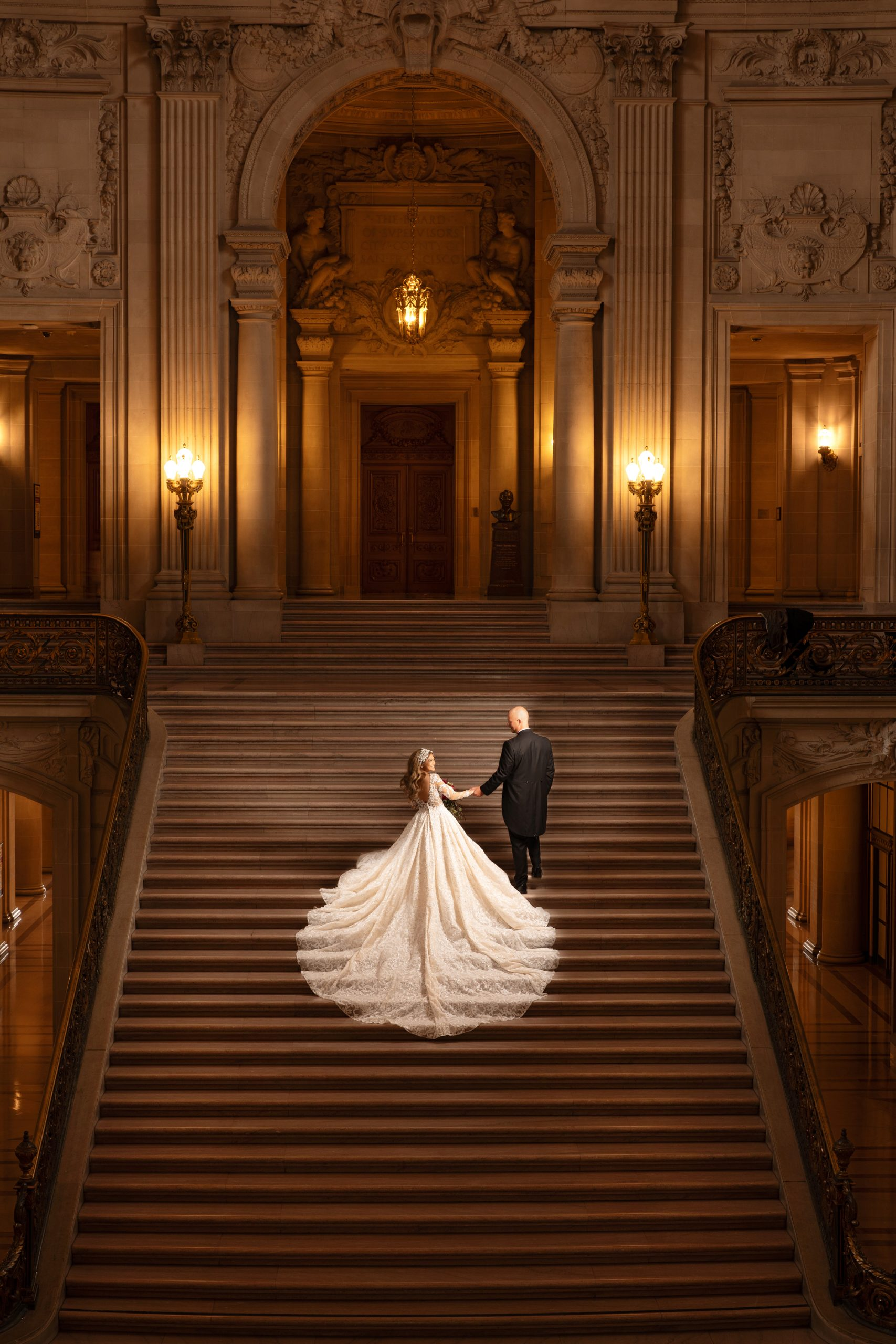 wedding gown long train sf city hall staircase