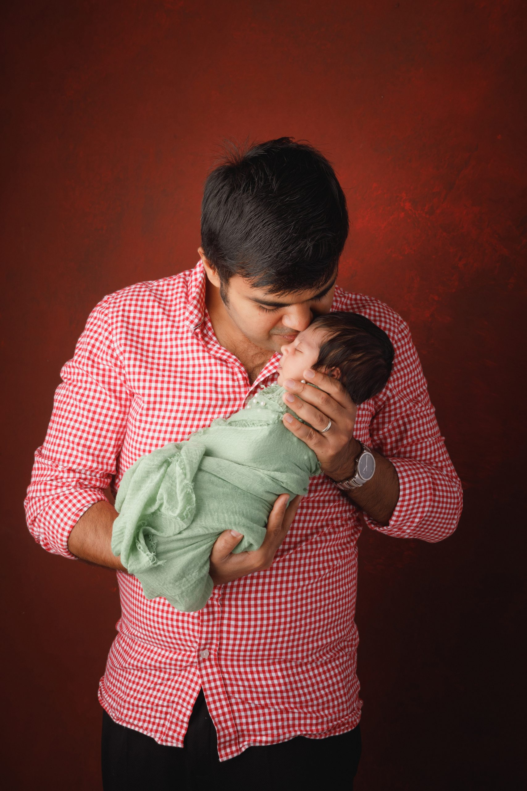 father with newborn baby girl